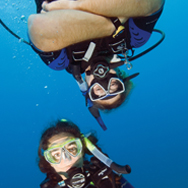 Neutrally buoyant scuba divers dive effortlessly